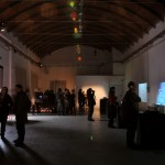 the exhibition space with lots of people around the OneAvatar installation