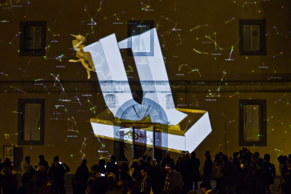 "U-Topia, projection mapping: the ""U"" appears and grows in the universe, a skye made of words"
